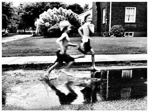 Children running in water
