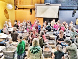 "Volunteers packing gift bags for ""Feed My Starving Children"""